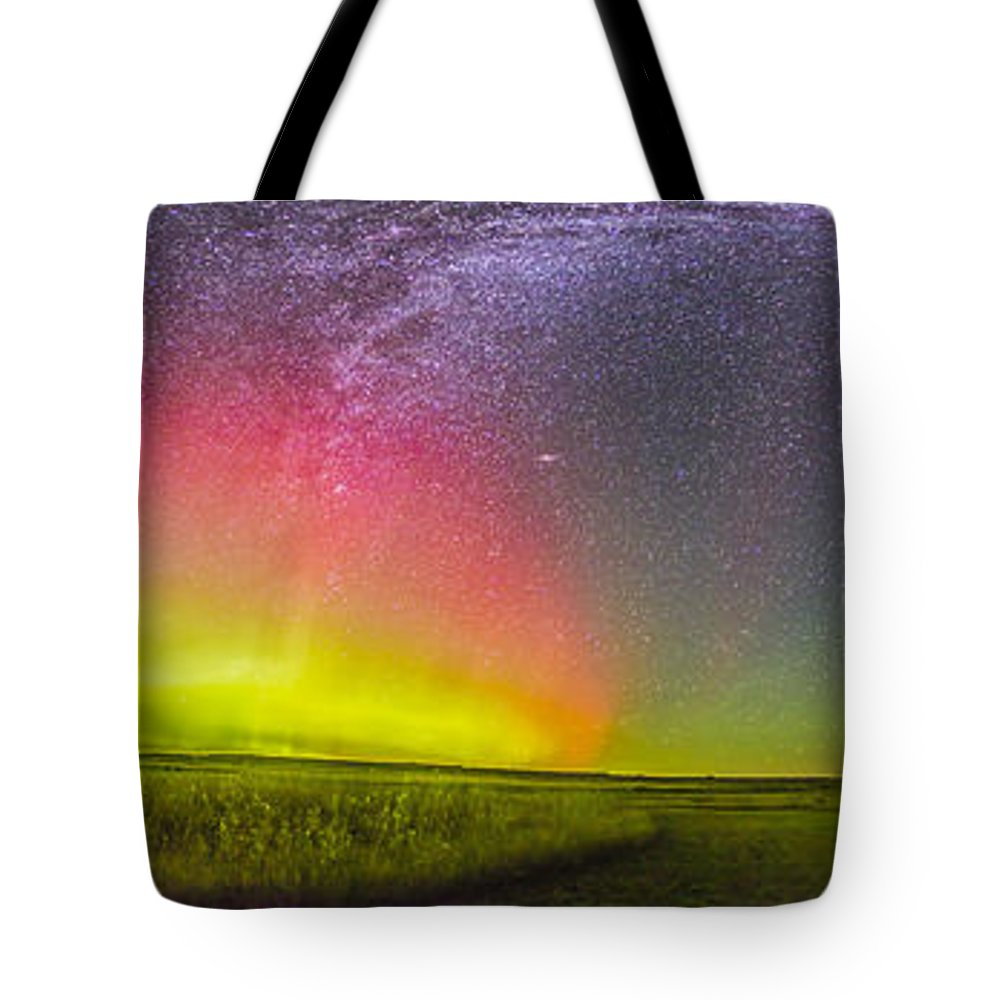 Aurora Tote Bag featuring the photograph Panorama Of An Aurora And The Milky Way by Alan Dyer