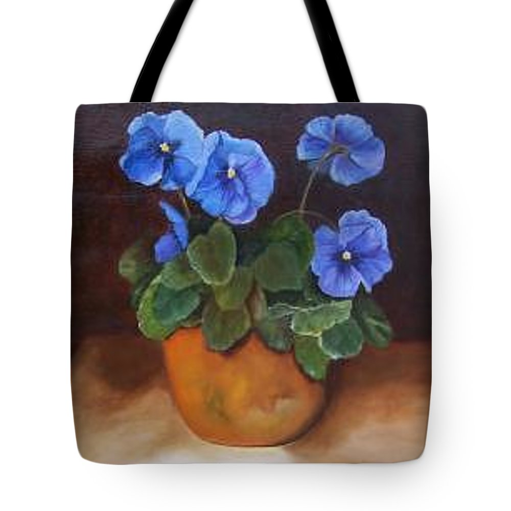 Blue And Purple Pansies In A Terracotta Pot Set Against A Dramatic Background Tote Bag featuring the painting Pansies In Terracotta by Susan Dehlinger