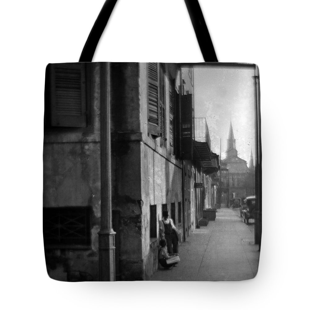 St Louis Cathedral Tote Bag featuring the photograph Paperboys by Crescent City Collective