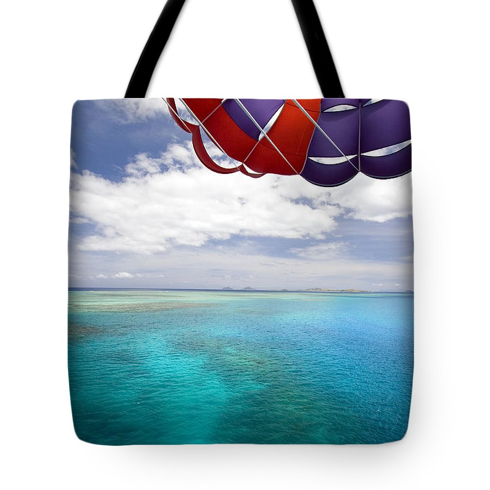 Adrenaline Tote Bag featuring the photograph Parasail Over Fiji by Dave Fleetham - Printscapes