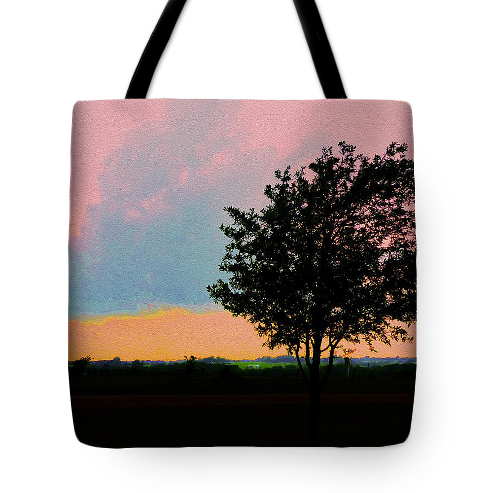 Sunset Tote Bag featuring the photograph Passing Storm Clouds by Robert J Sadler