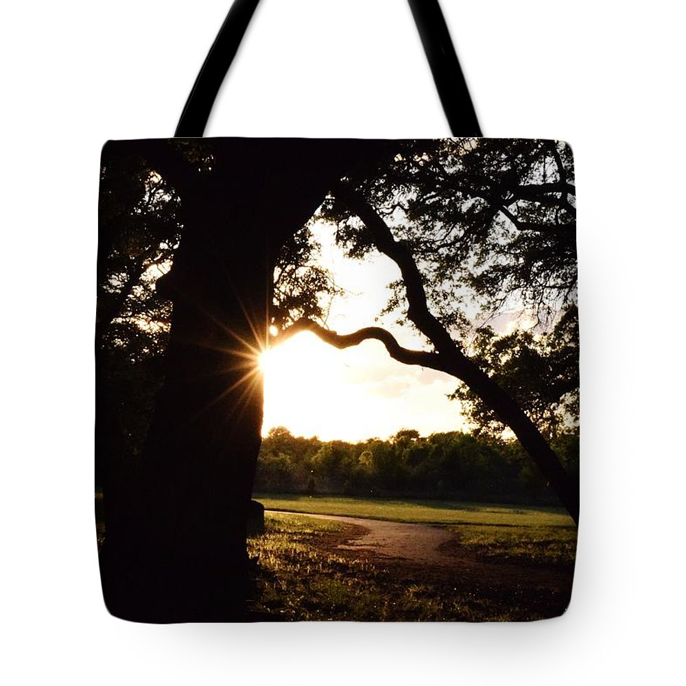Sunset Tote Bag featuring the photograph Path Into The Sun by Charles F Miller