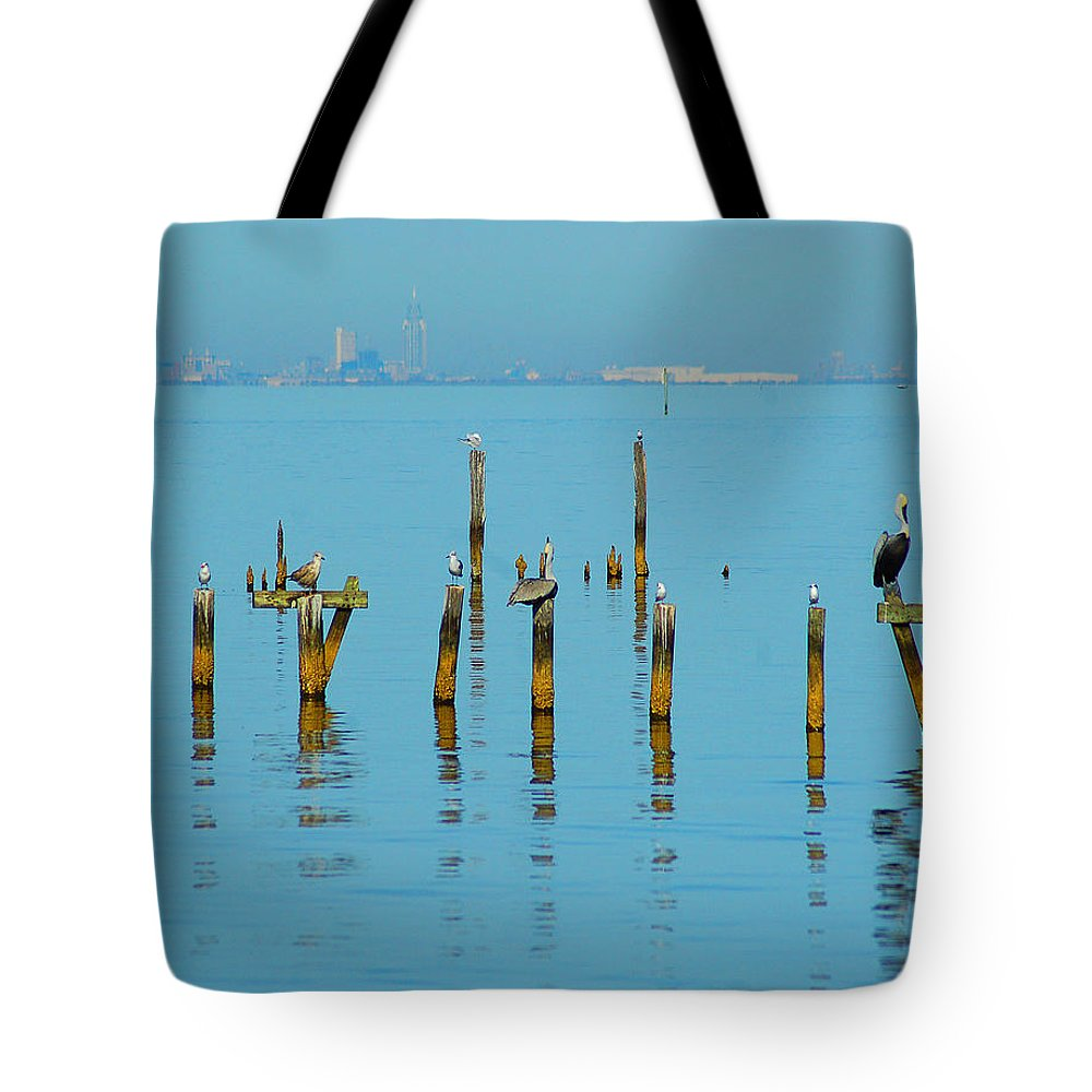 Pelican Tote Bag featuring the digital art Pelican And Mobile by Michael Thomas