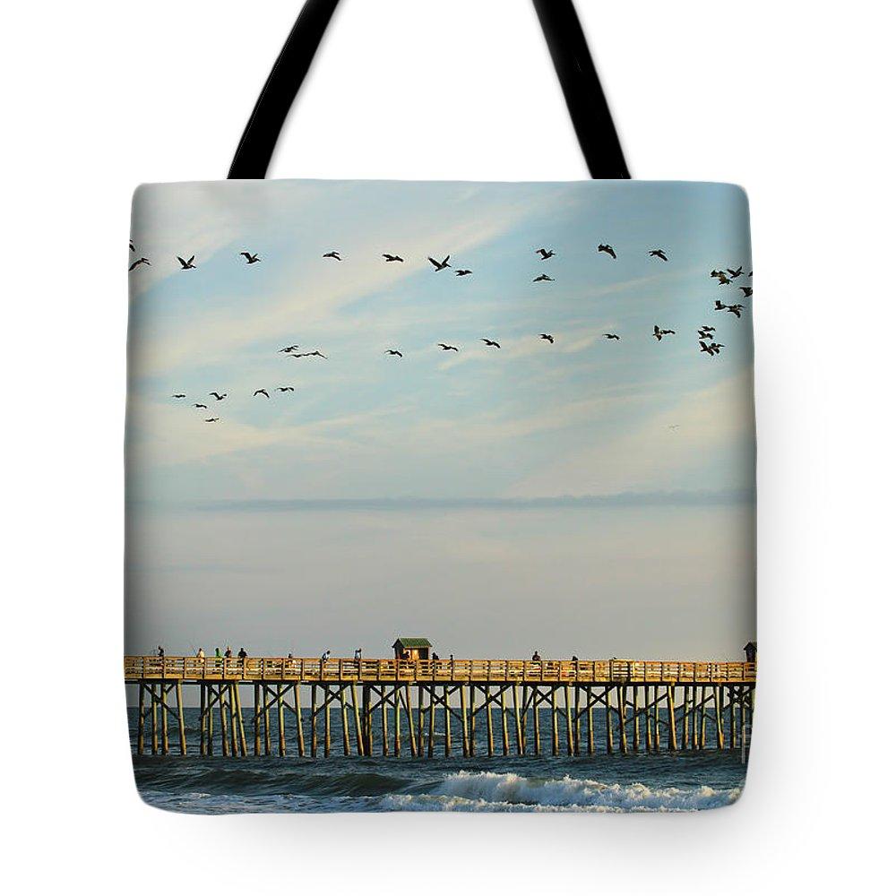 Flagler Tote Bag featuring the photograph Pelicans At Flagler Beach by Deborah Benoit