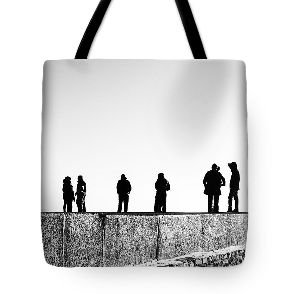 Landscape Tote Bag featuring the photograph People Standing In Groups Abstract Monchrome by John Williams