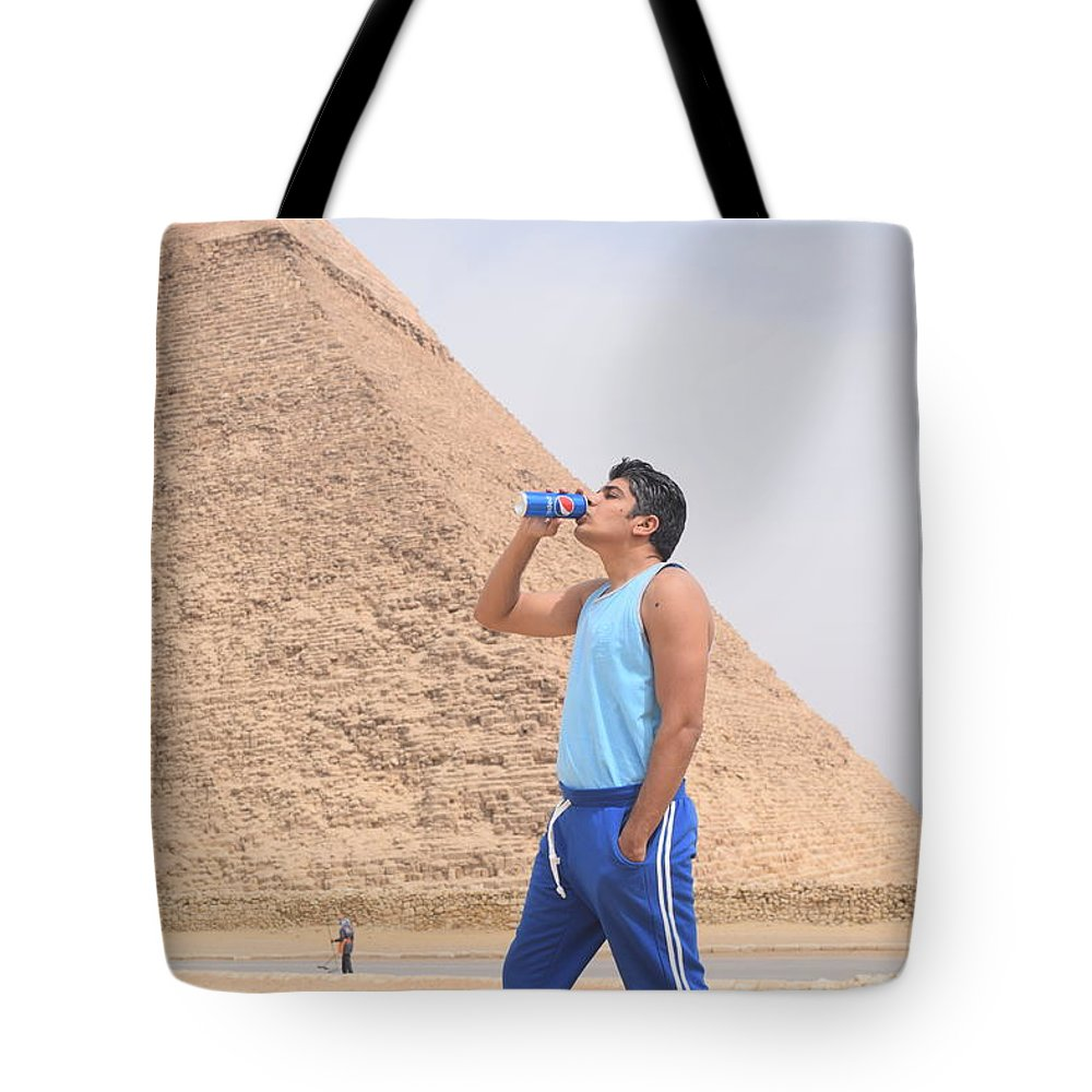 Pepsi Tote Bag featuring the photograph Pepsi Advertisement by Motaz Mohamed