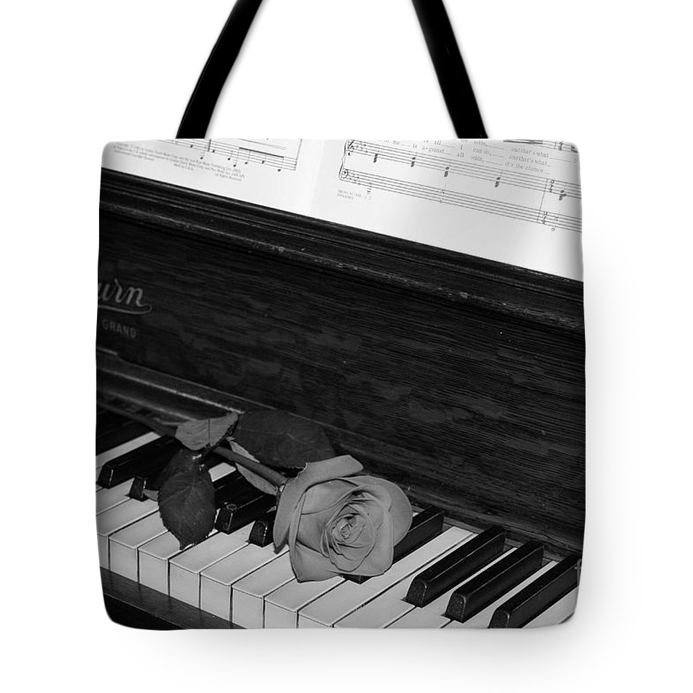 Black And White Tote Bag featuring the photograph Piano Rose by Crystal Nederman