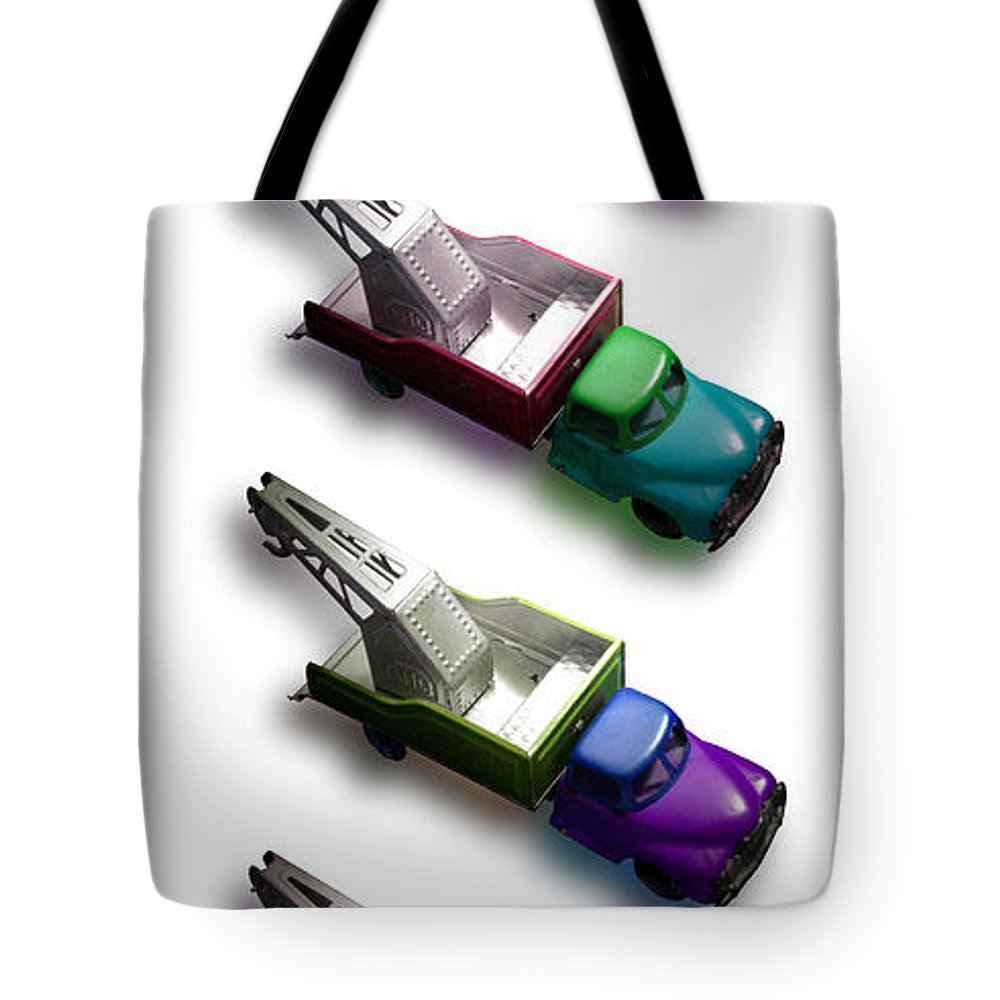 Toy Tote Bag featuring the photograph Pick Me Up by Charles Stuart