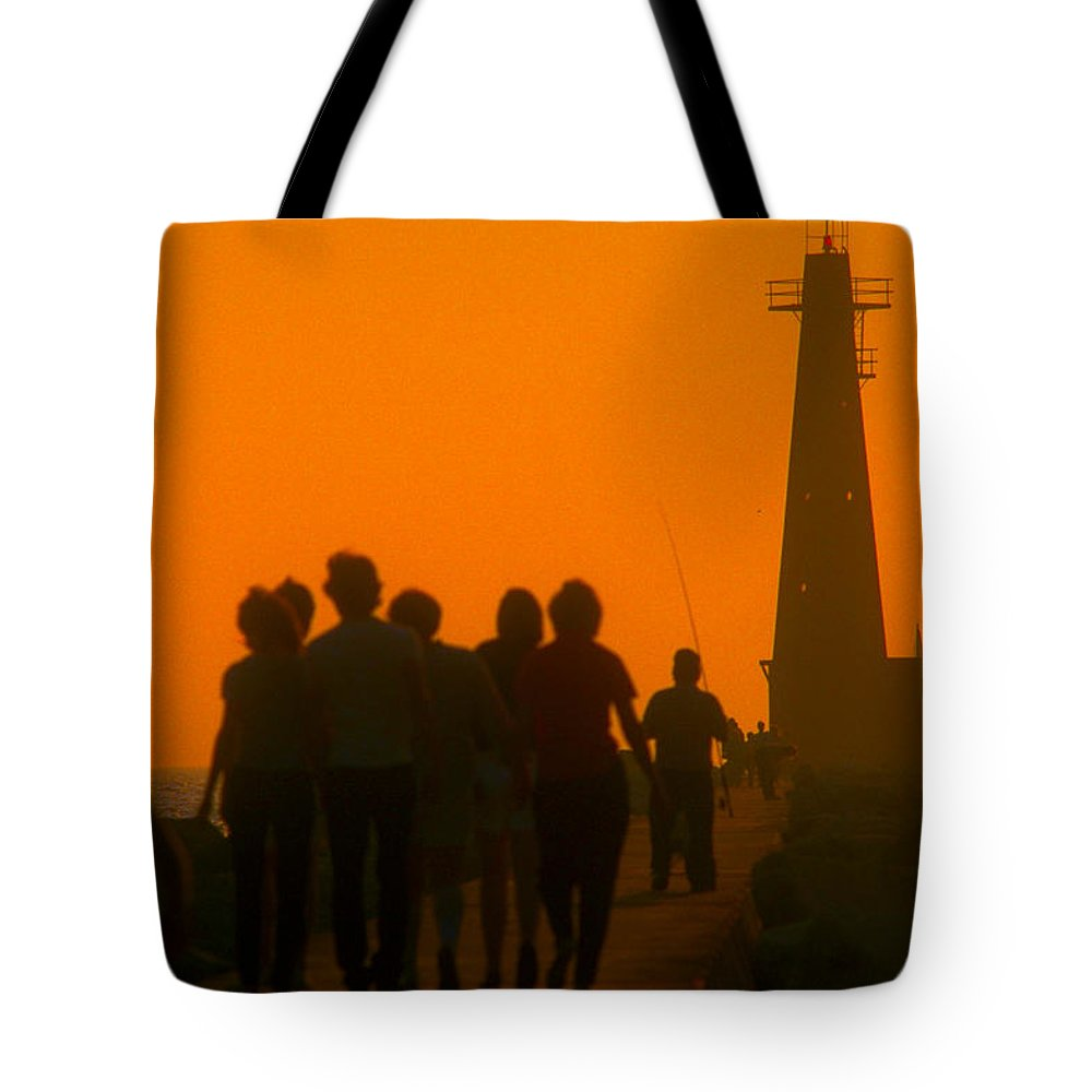 Photography Tote Bag featuring the photograph Pier Walkers by Frederic A Reinecke