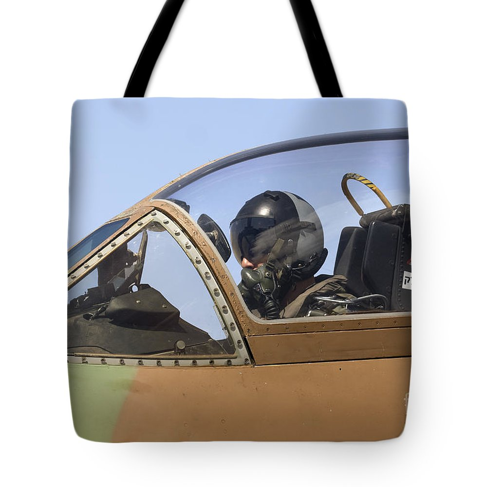 Aircraft Tote Bag featuring the photograph Pilot In The Cockpit Of A Skyhawk Fighter Jet by Nir Ben-Yosef