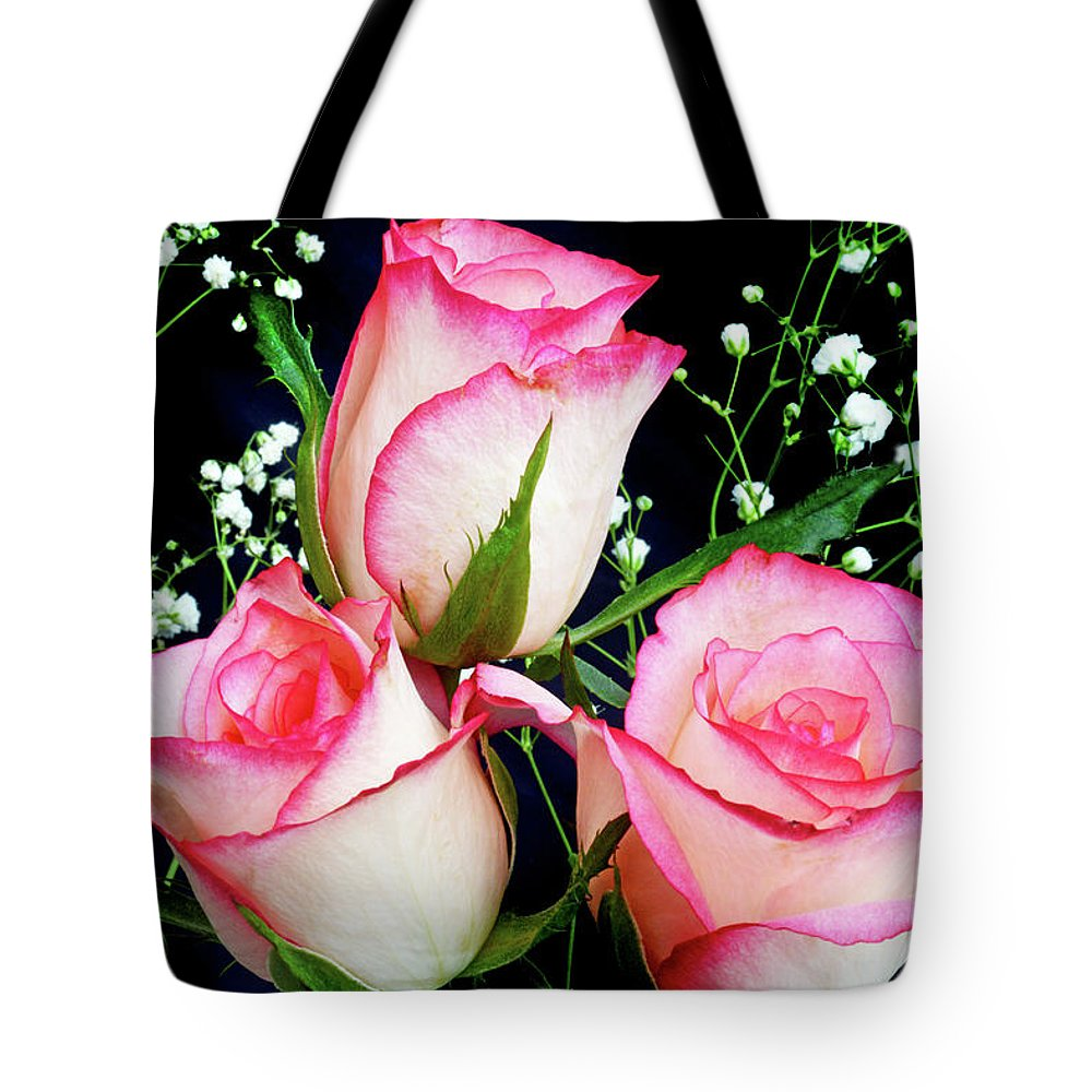 Roses Tote Bag featuring the photograph Pink And White Roses by Terence Davis