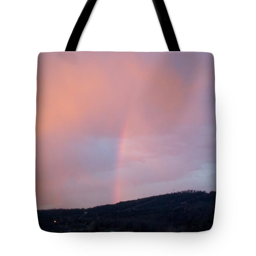 Pink Clouds Tote Bag featuring the photograph Pink clouds with rainbow by Toni Berry
