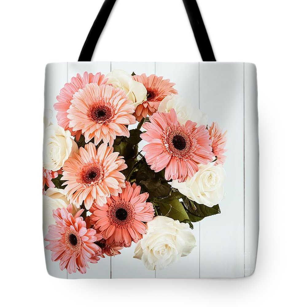 Pink gerbera daisy flowers and white roses bouquet tote bag for sale bouquet tote bag featuring the photograph pink gerbera daisy flowers and white roses bouquet by radu izmirmasajfo Images