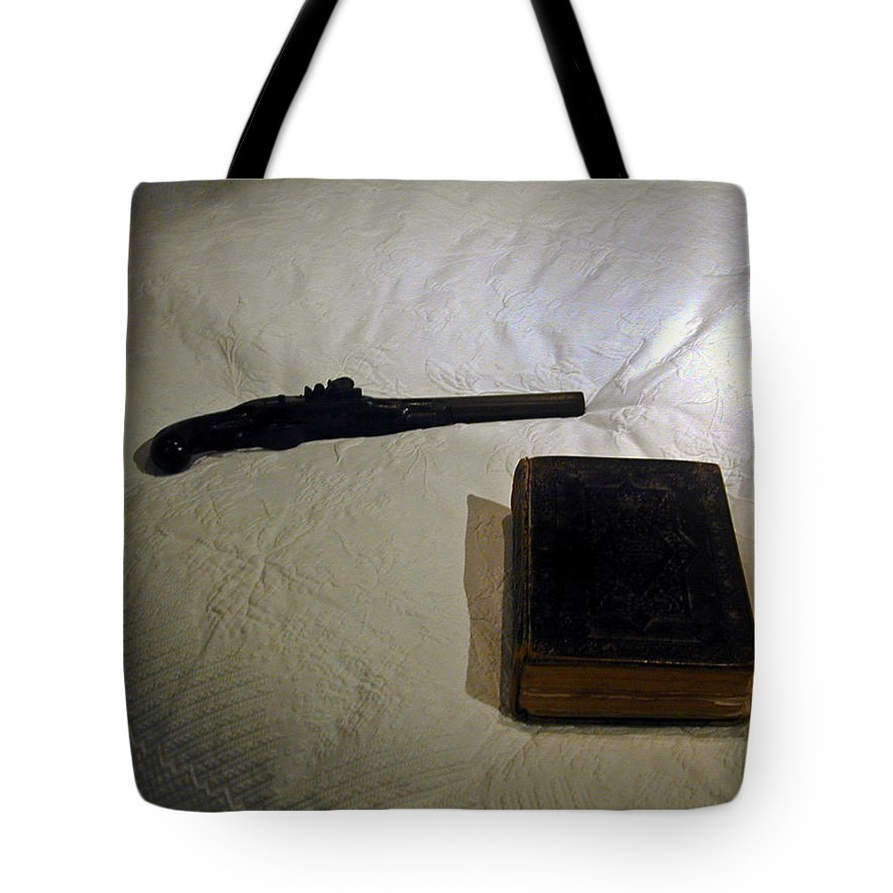 Pistol Tote Bag featuring the photograph Pistol And Bible by Douglas Barnett