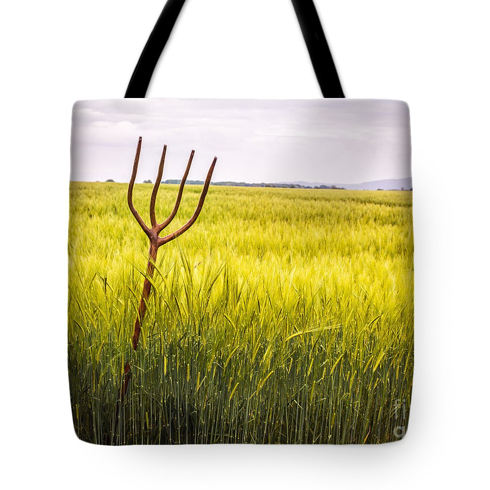 Pitch Tote Bag featuring the photograph Pitch Fork In Wheat Field by Amanda Elwell