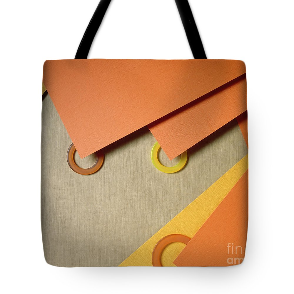 Abstract Tote Bag featuring the photograph Plastic Circles And Paper by Stefania Levi