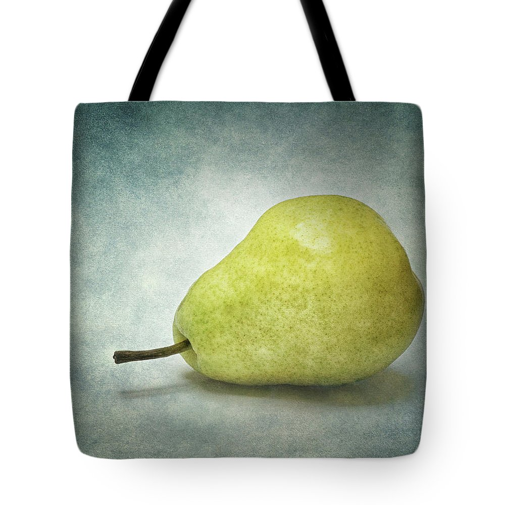 Green Pear Tote Bag featuring the photograph Plump Pear by Kathi Mirto