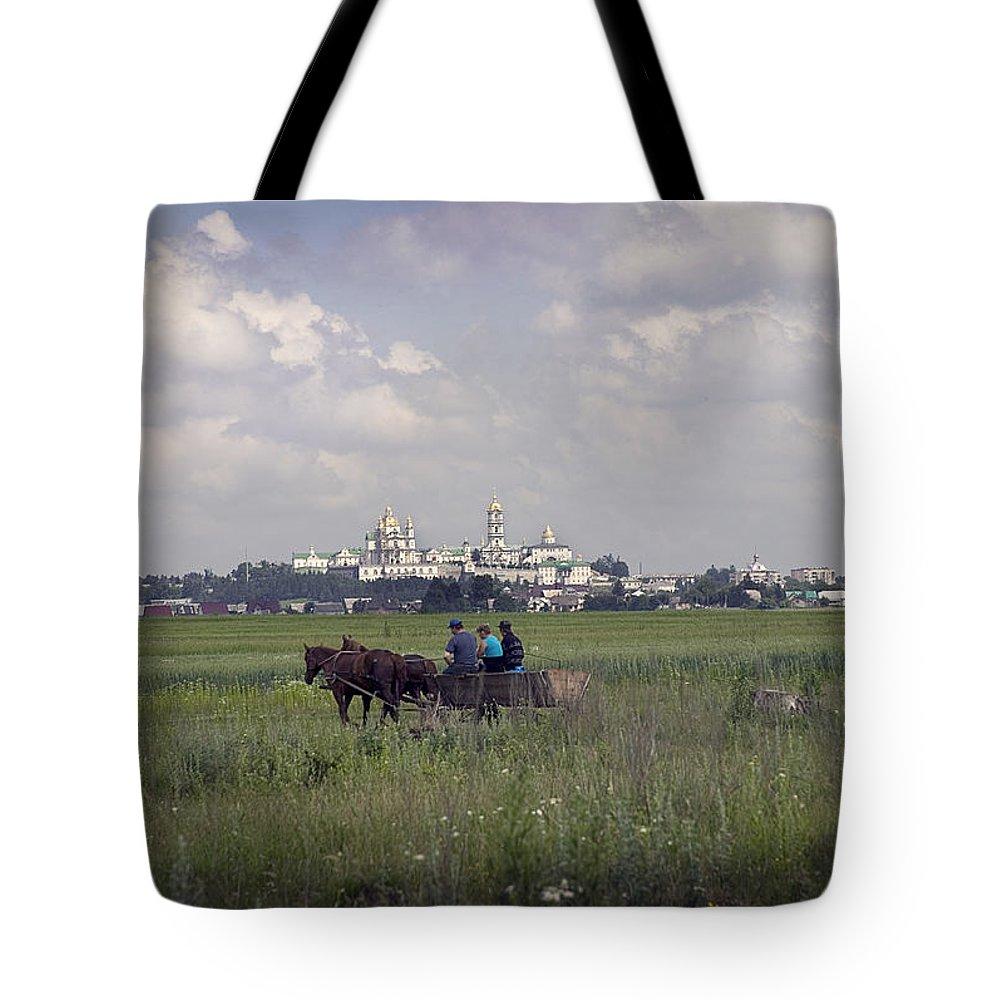 Ukraine Tote Bag featuring the photograph Pochaiv Monastery Ukraine by Yuri Lev