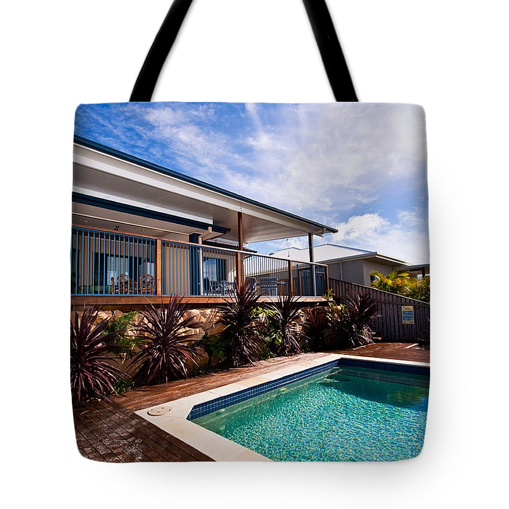 Deck Tote Bag featuring the photograph Poll And House With Deck by Darren Burton