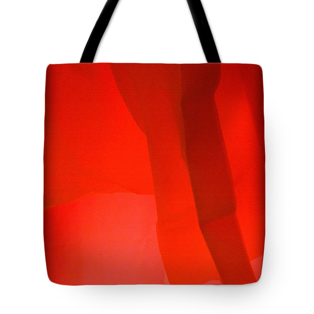 Red Tote Bag featuring the photograph Poncho Abstract 3 by Jeff Breiman