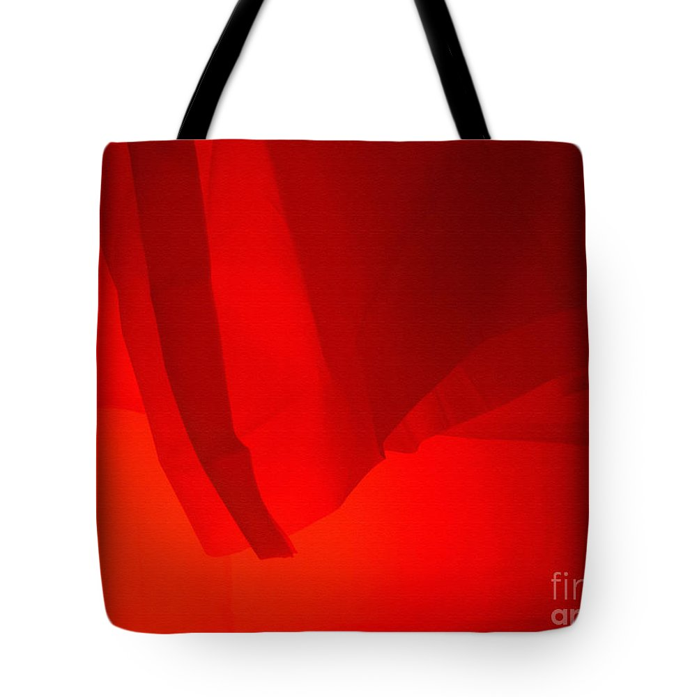 Red Tote Bag featuring the photograph Poncho Abstract 7 by Jeff Breiman