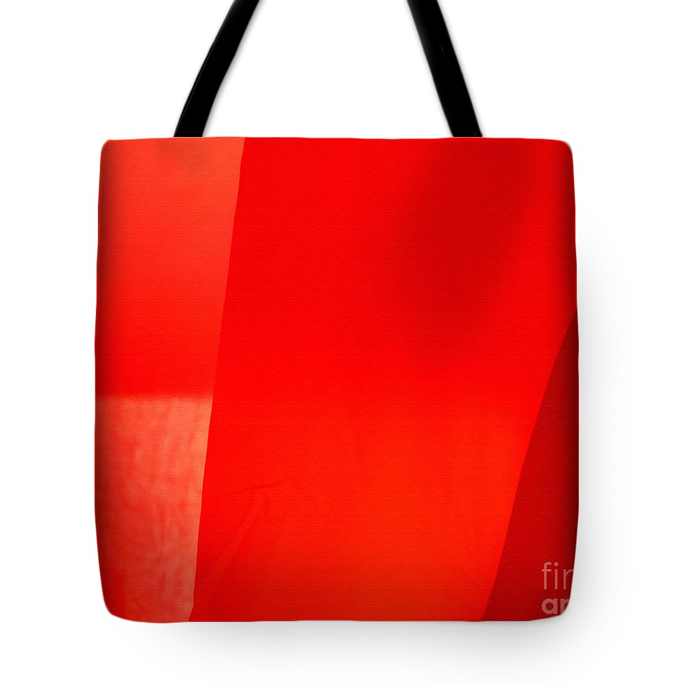Red Tote Bag featuring the photograph Poncho Abstract 9 by Jeff Breiman