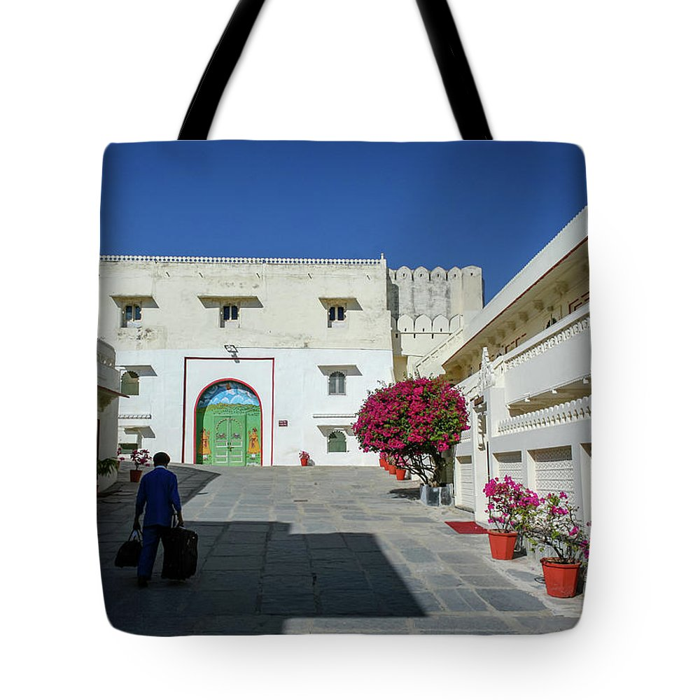 Courtyard Tote Bag featuring the photograph Porter, Udaipur, Rajasthan by Aashish Vaidya