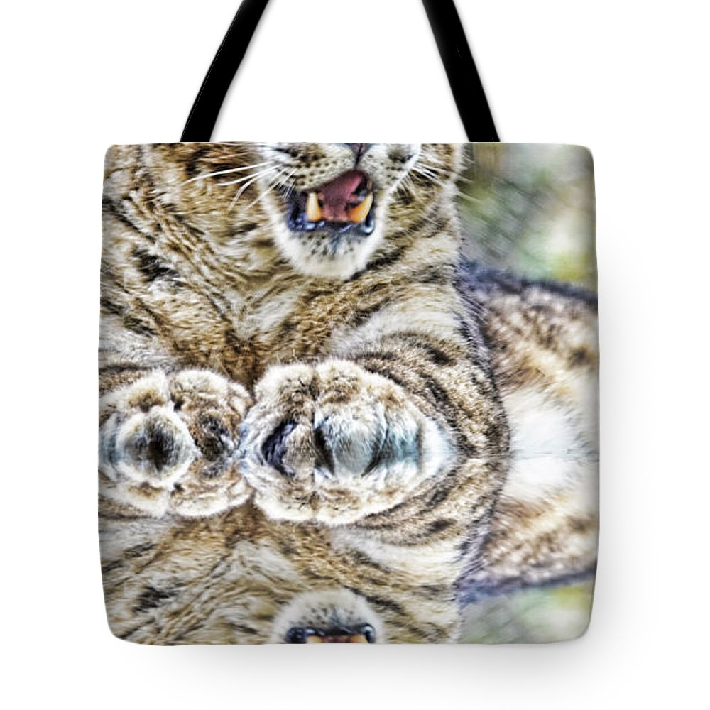 Snow Leopard Tote Bag featuring the photograph Portrait Of A Snow Leopard With A Reflection by Jim Fitzpatrick