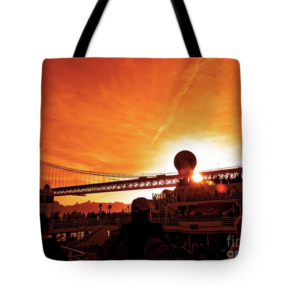 25 De Abril Bridge Tote Bag featuring the photograph Sunset Under The 25 April Bridge Lisbon by Wilf Doyle