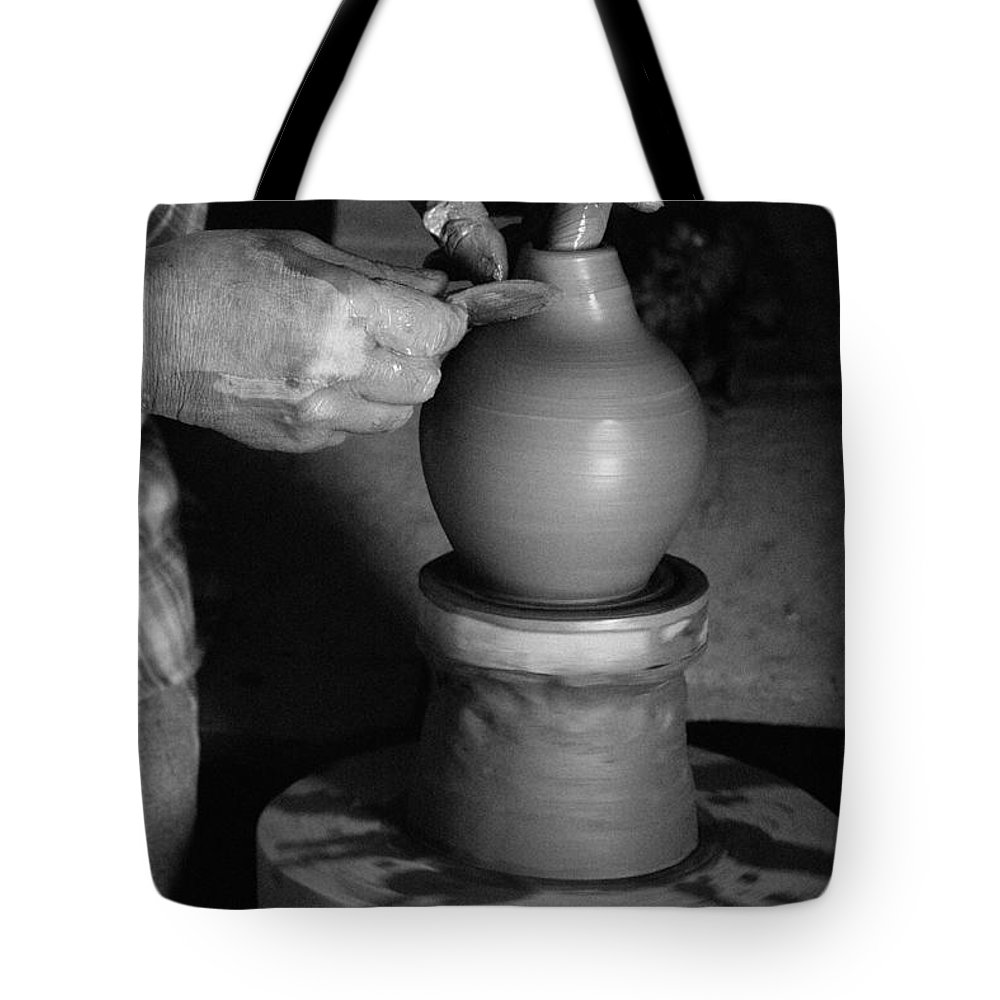Azores Tote Bag featuring the photograph Potter At Work by Gaspar Avila