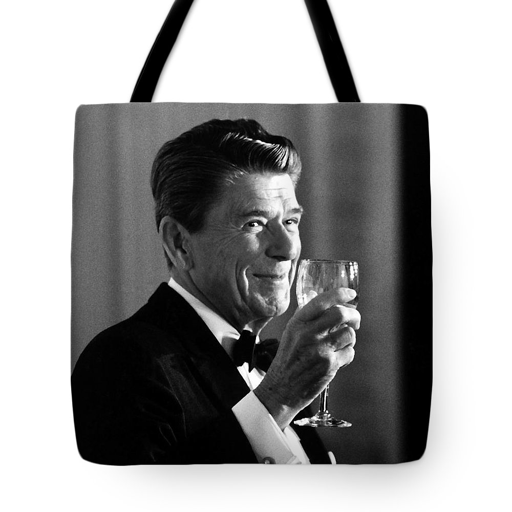 Ronald Reagan Tote Bag featuring the painting President Reagan Making A Toast by War Is Hell Store
