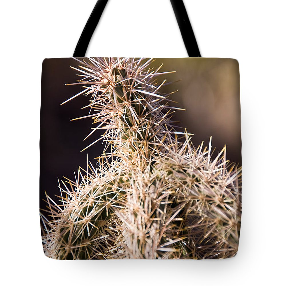 Prick Tote Bag featuring the photograph Prick by Charles Dobbs