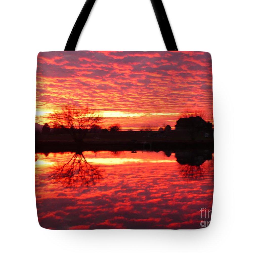 Orange Tote Bag featuring the photograph Dramatic Orange Sunset by Carol Groenen