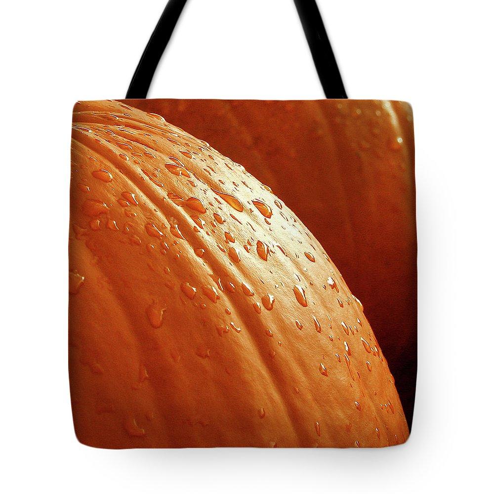 Orange Tote Bag featuring the photograph Pumpkin Dew by Greg Joens