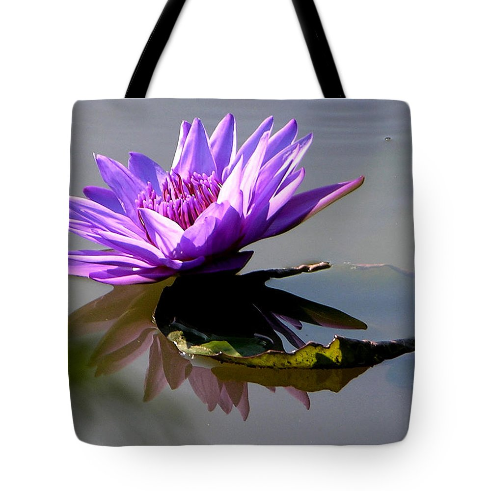 Water Lily Tote Bag featuring the photograph Purple Beauty On The Pond by John Lautermilch