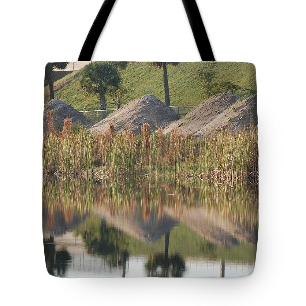 Grass Tote Bag featuring the photograph Pyrimids By The Lakeside Cache by Rob Hans