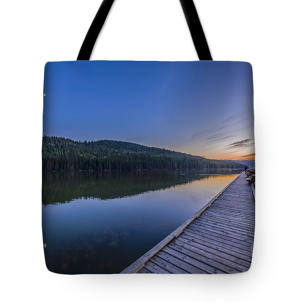 Conjunction Tote Bag featuring the photograph Quarter Moon Reflected In The Waters by Alan Dyer