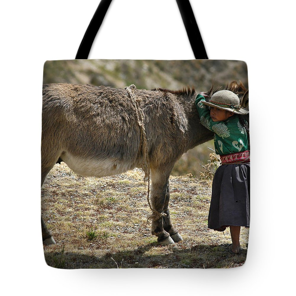 Girl Tote Bag featuring the photograph Quechua Girl Hugging His Donkey. Republic Of Bolivia. by Eric Bauer