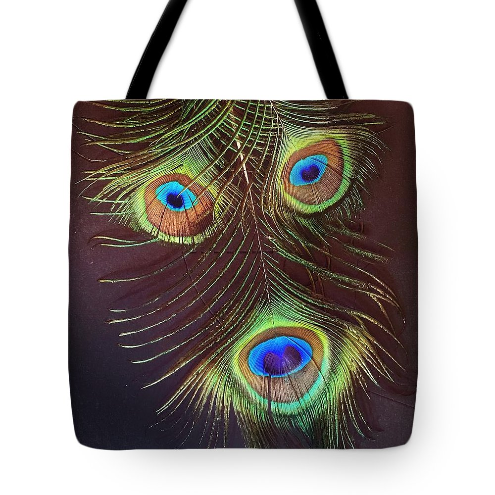 Peacock Tote Bag featuring the photograph Raffiki Peacock by Doris Aguirre