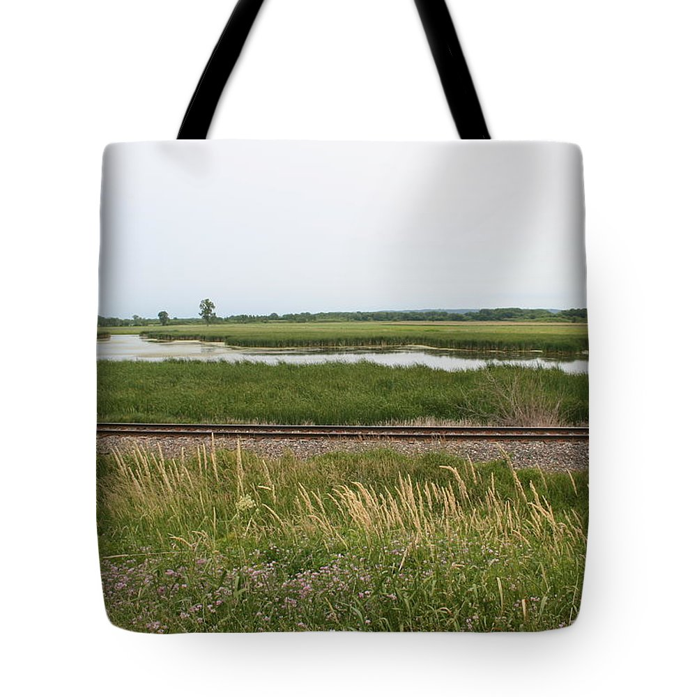 Rail Refuge Tote Bag featuring the photograph Rail Refuge by Dylan Punke