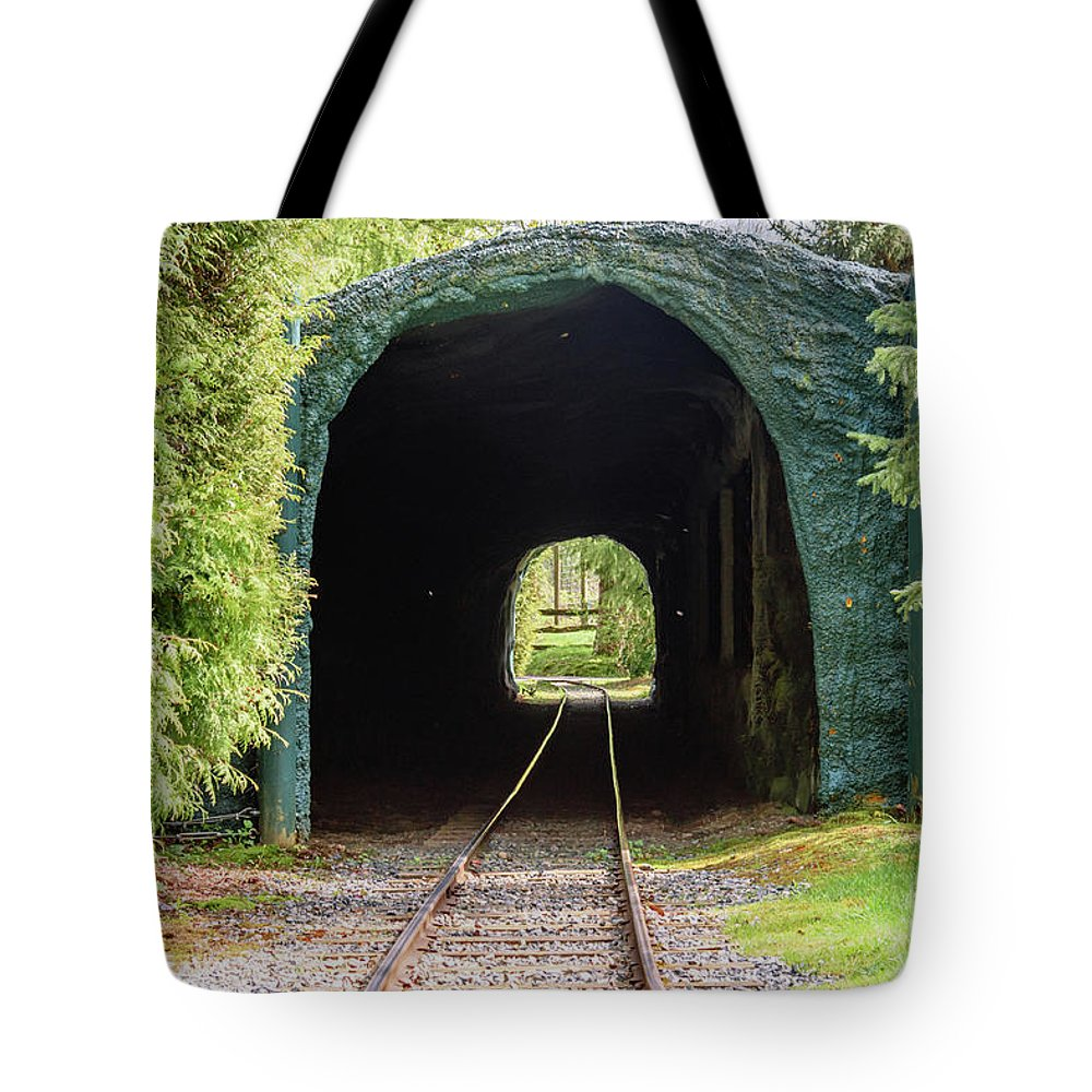 Tunnel Tote Bag featuring the photograph The Railway Passing Through The Tunnel To Meet The Light by Viktor Birkus