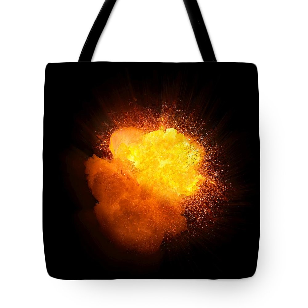Fuel Tote Bag featuring the photograph Realistic Fire Explosion, Orange Color With Smoke And Sparks by Lukasz Szczepanski