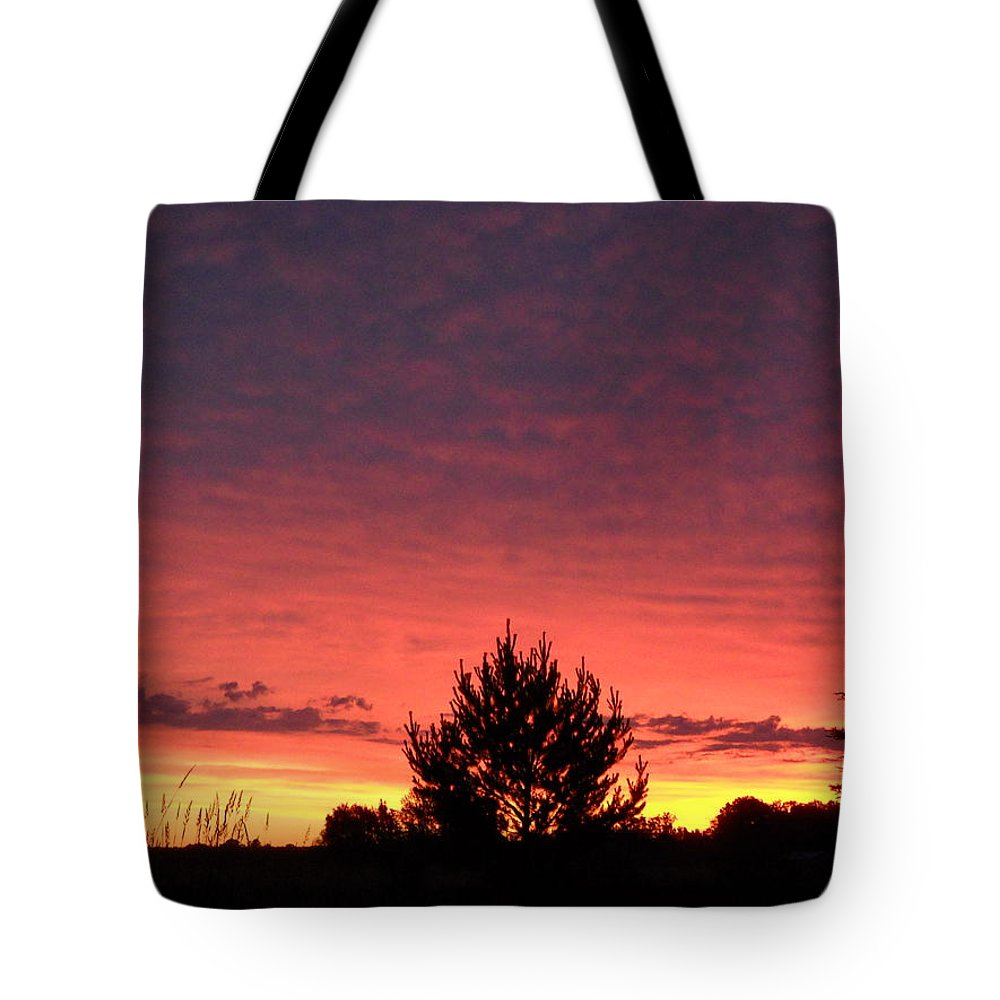 Clouds Tote Bag featuring the photograph Red And Orange June Dawn Sky by Kent Lorentzen