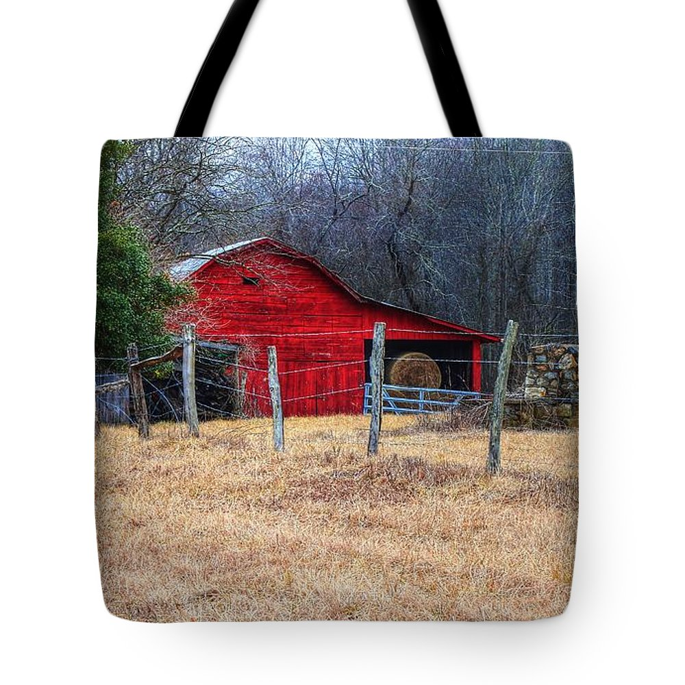 Red Barn Winter Tote Bag featuring the photograph Red Barn A Long The Way by Carol Montoya