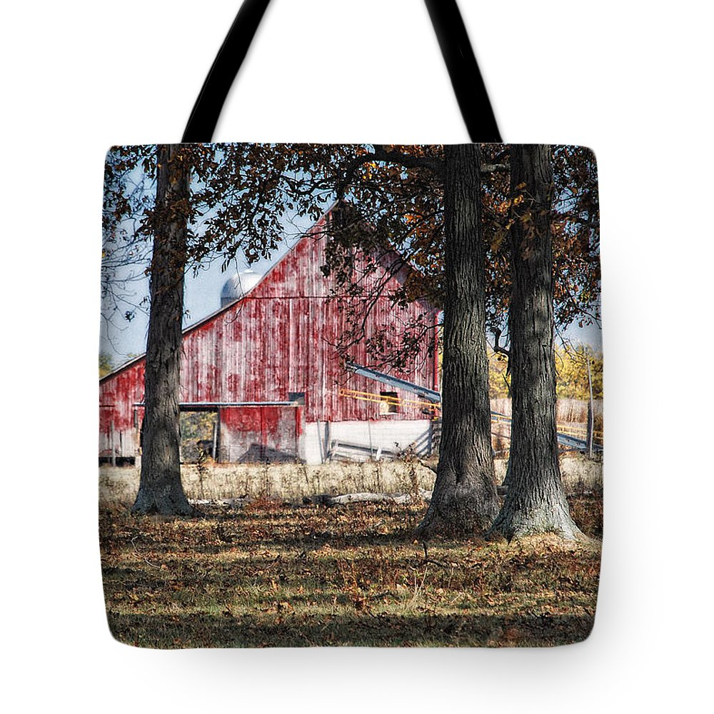Agriculture Tote Bag featuring the photograph Red Barn Through The Trees by Pamela Baker