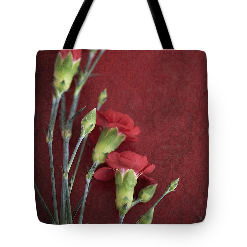 Flowers Tote Bag featuring the photograph Red Carnation Stems by Di Kerpan