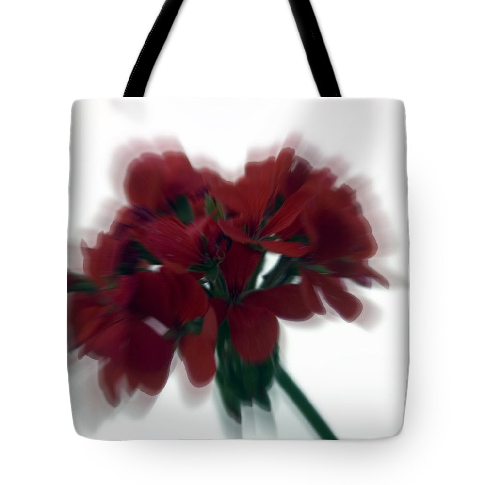 Red Tote Bag featuring the photograph Red Flower Motion by Cliff Norton