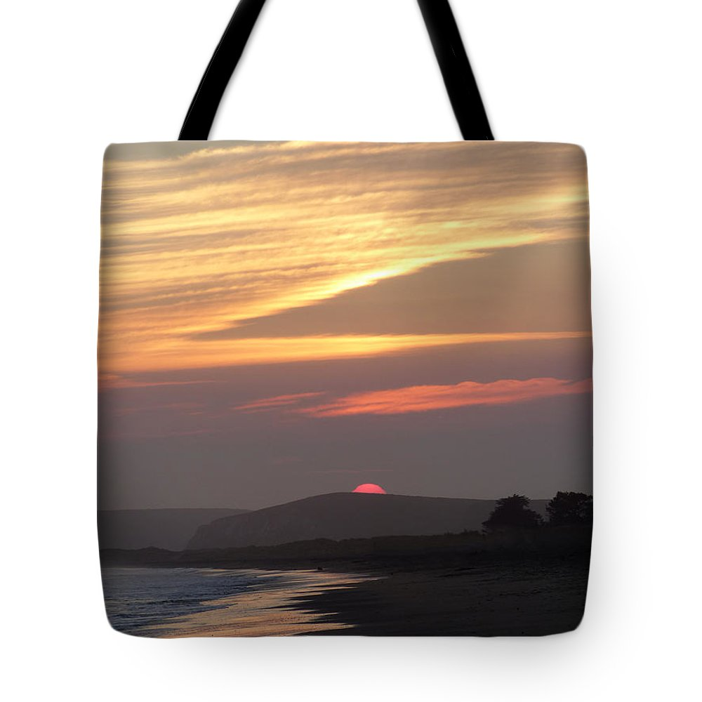 Sunset Tote Bag featuring the photograph Red Half Dome Of Sun And Zig Zag Clouds And Surf by Andrea Freeman