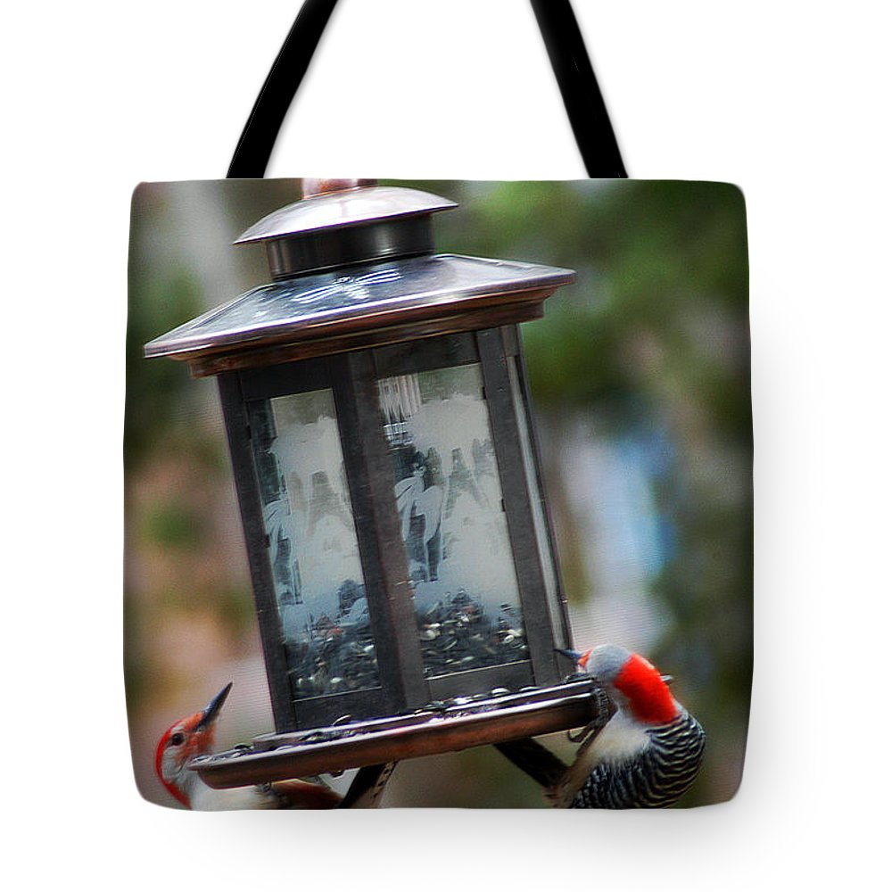 Clay Tote Bag featuring the photograph Red Head Wood Peckers On Feeder by Clayton Bruster