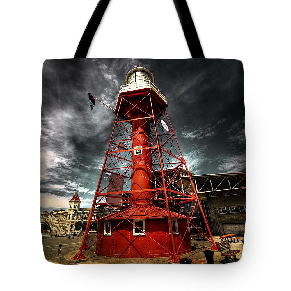 Lighthouse Tote Bag featuring the photograph Red Lighthouse by Wayne Sherriff